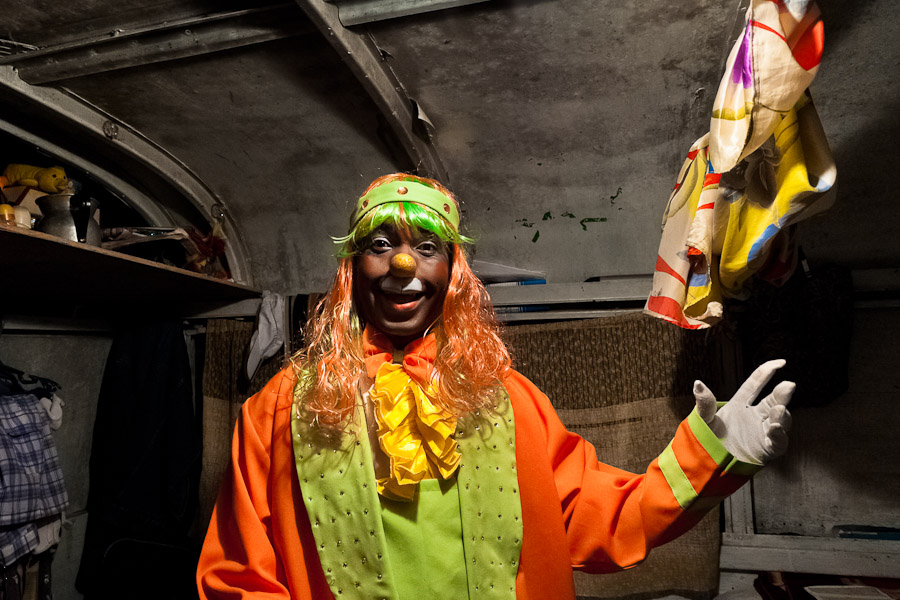 Walter, a Colombian clown, in his costume and makeup before a performance at the Circus Anny.