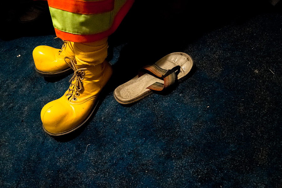 A Colombian man wears the yellow clown shoes before a performance.